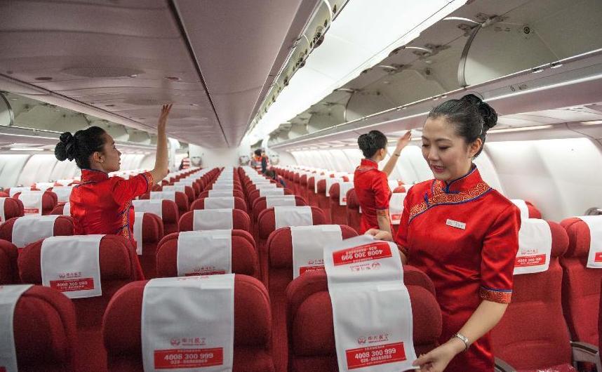 Descripción: Forma de Sichuan Airlines asistentes de vuelo de la línea aérea. Chengdu, Kitay.2
