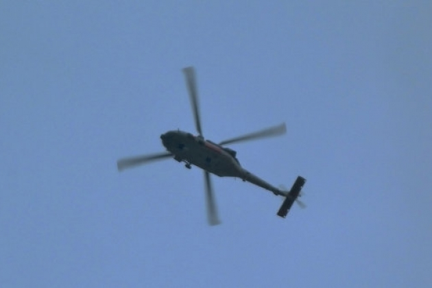 The helicopter in the sky