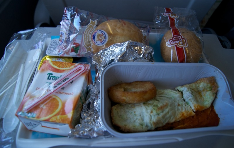 Economy class on a plane. Food.